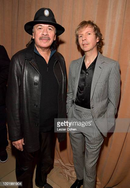 Carlos Santana and Beck attend the PreGRAMMY Gala and GRAMMY Salute to Industry Icons Honoring Sean Diddy Combs on January 25 2020 in Beverly Hills...