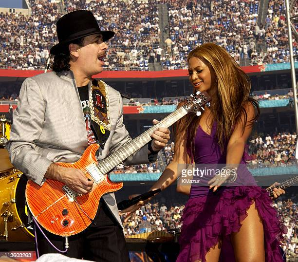 Carlos Santana and Beyonce Knowles during Super Bowl XXXVII Pregame Show at Qualcomm Stadium in San Diego California United States