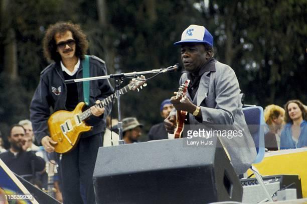 Carlos Santana and John Lee Hooker performing in Golden Gate park in San Francisco California on June 23 1985