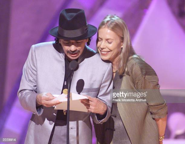 Carlos Santana and Joni Mitchell at the 43rd Annual Grammy Awards broadcast at Staples Center in Los Angeles CA on February 21 2001