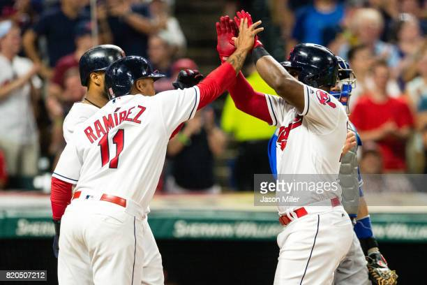 Carlos Santana and Jose Ramirez celebrate with Abraham Almonte of the Cleveland Indians after all scored on a home run by Almonte during the seventh...