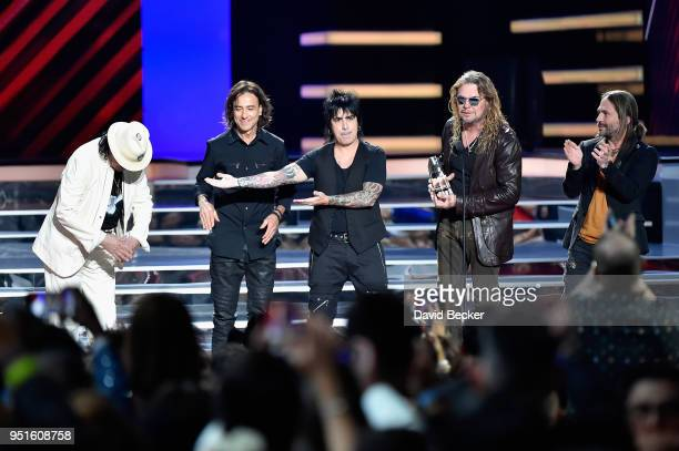 Carlos Santana and Juan Calleros Alex Gonzalez Fher Olvera and Sergio Vallin of Mana onstage at the 2018 Billboard Latin Music Awards at the Mandalay...