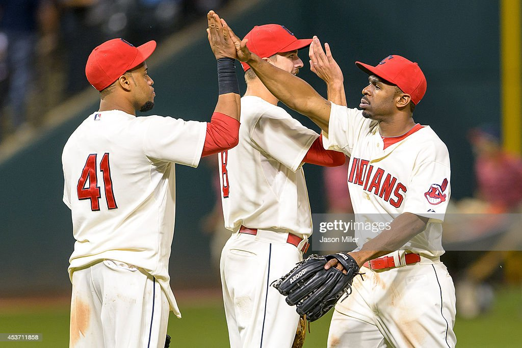 Carlos Santana #41 and Lonnie Chisenhall #8 celebrate with Michael Bourn #24 of the Cleveland Indians after the Indians defeated the Baltimore Orioles at Progressive Field on August 16, 2014 in Cleveland, Ohio. The Indians defeated the Orioles 6-0.