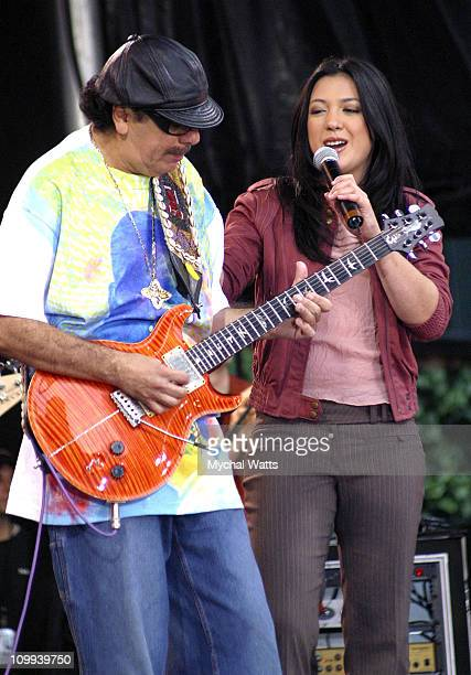 Carlos Santana and Michele Branch during Carlos Santana Performs on Good Morning America 2003 Concert Series at Bryant Park in New York City, New...