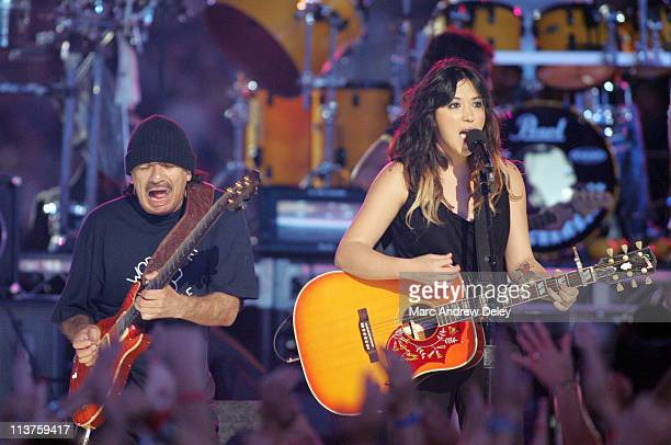 Carlos Santana and Michelle Branch during 2005 NFL Kickoff - Foxboro Concert at Gillette Stadium in Foxboro, Massachusetts, United States.