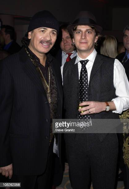 Carlos Santana and Rob Thomas during 2004 Clive Davis PreGrammy Party Backstage and Audience at Beverly Hills Hotel in Beverly Hills California...