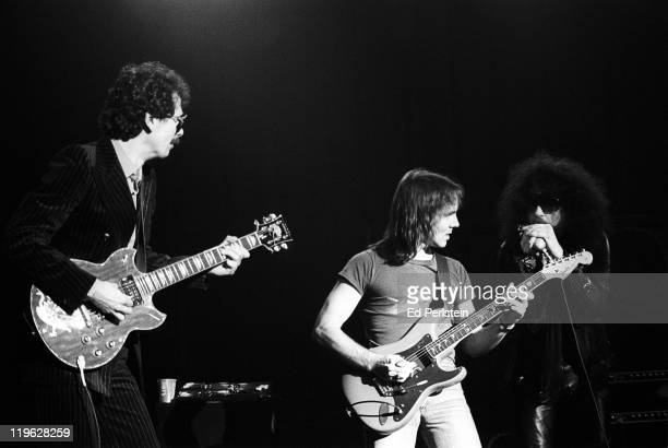 Carlos Santana and Ronnie Montrose jam with Magic Dick of the J Geils Band at the Oakland Auditorium on March 24 1979 in Oakland California