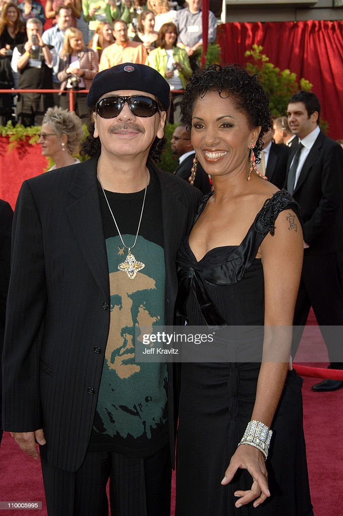 Carlos Santana and wife Deborah King Santana during The 77th Annual Academy Awards - Arrivals at Kodak Theatre in Los Angeles, California, United States.
