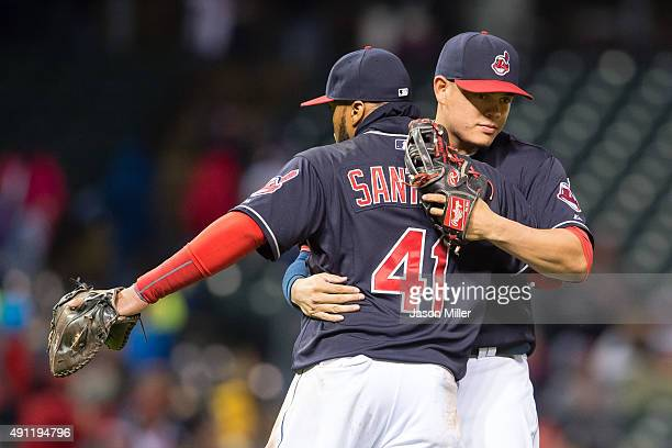 Carlos Santana celebrates with Giovanny Urshela of the Cleveland Indians after the Indians defeated the Boston Red Sox at Progressive Field on...