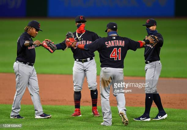 Carlos Santana celebrates with Jose Ramirez and Francisco Lindor of the Cleveland Indians after a 6-3 win over the Pittsburgh Pirates at PNC Park on...