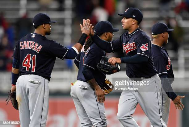 Carlos Santana Michael Martinez Michael Brantley and Jose Ramirez of the Cleveland Indians celebrate winning the game against the Minnesota Twins on...