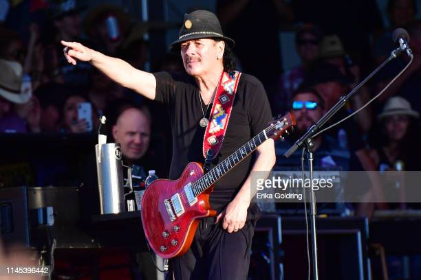 Carlos Santana of Santana performs during the 2019 New Orleans Jazz Heritage Festival 50th Anniversary at Fair Grounds Race Course on April 26 2019...