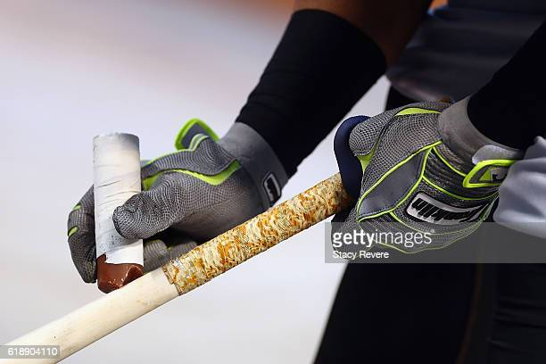 Carlos Santana of the Cleveland Indians adds pine tar to his bat during batting practice before Game Three of the 2016 World Series against the...