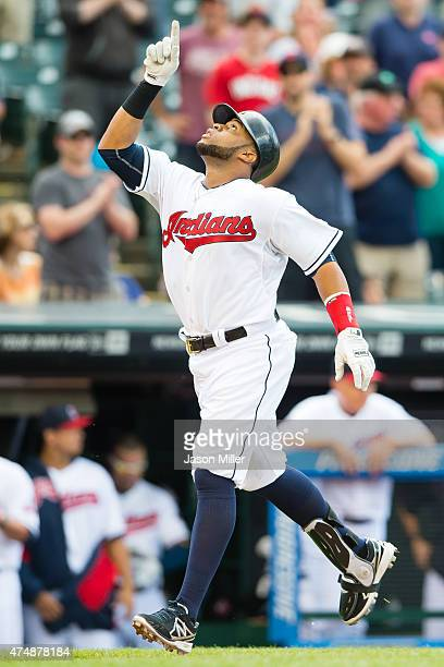 Carlos Santana of the Cleveland Indians celebrates after hitting a three run home run during the third inning against the Texas Rangers at...