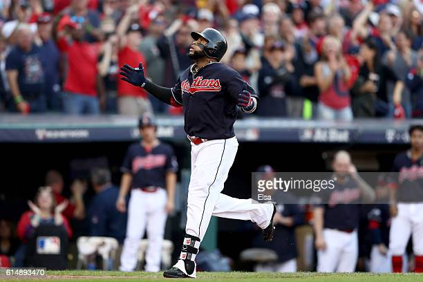 Carlos Santana of the Cleveland Indians celebrates after hitting a home run in the second inning against JA Happ of the Toronto Blue Jays during game...