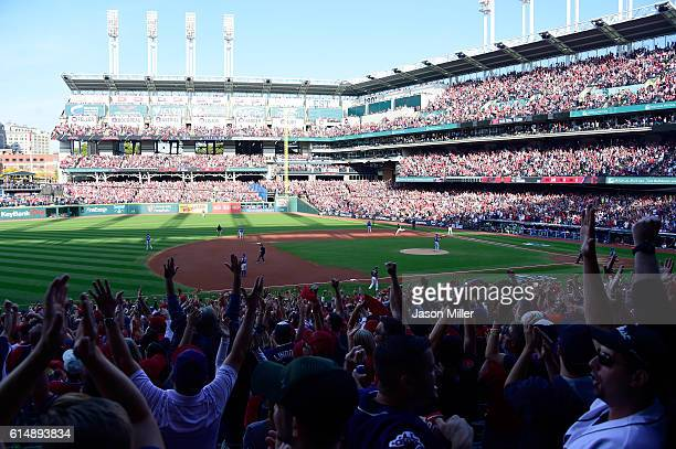 Carlos Santana of the Cleveland Indians celebrates after hitting a home run in the second inning against J.A. Happ of the Toronto Blue Jays during...