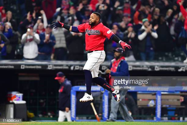Carlos Santana of the Cleveland Indians celebrates as he rounds the bases after hitting a walk-off solo home run during the ninth inning against the...