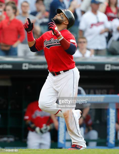 Carlos Santana of the Cleveland Indians celebrates his home run against the Baltimore Orioles pitcher Miguel Castro in the eighth inning at...
