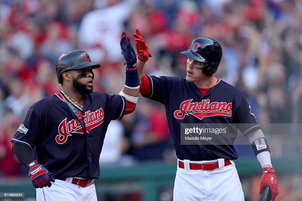 Carlos Santana #41 of the Cleveland Indians celebrates with Brandon Guyer #6 after hitting a home run in the second inning against J.A. Happ #33 of the Toronto Blue Jays during game two of the American League Championship Series at Progressive Field on October 15, 2016 in Cleveland, Ohio.