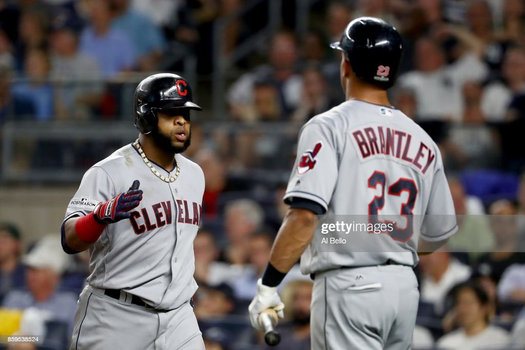 Carlos Santana #41 of the Cleveland Indians celebrates with Michael Brantley #23 after hitting a two run home run scoring Jay Bruce #32 against Luis Severino #40 of the New York Yankees during the fourth inning in Game Four of the American League Divisional Series at Yankee Stadium on October 9, 2017 in the Bronx borough of New York City.