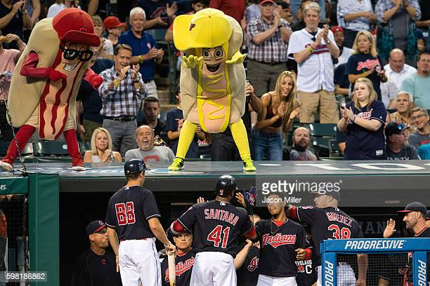 Carlos Santana of the Cleveland Indians celebrates with teammates after hitting a solo home run during the fourth inning against the Minnesota Twins...