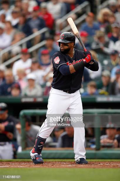 Carlos Santana of the Cleveland Indians gets ready for the next pitch during the Spring Training game against the Cincinnati Reds at Goodyear...