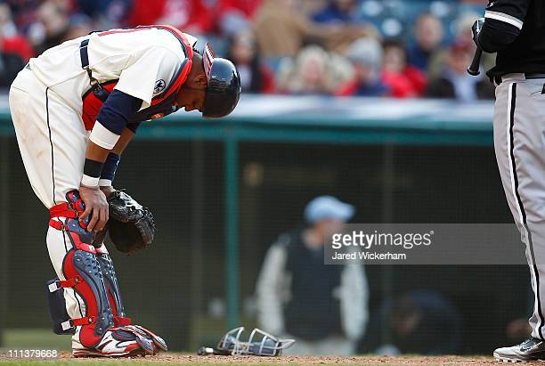 Carlos Santana of the Cleveland Indians has a moment to himself after getting hit near the neck with a pitch against the Chicago White Sox during the...