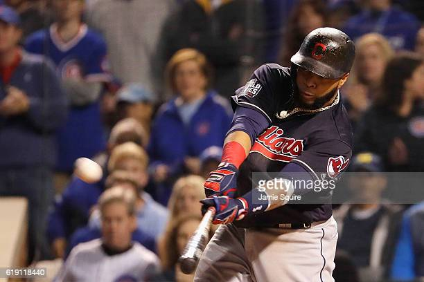 Carlos Santana of the Cleveland Indians hits a home run in the second inning against the Chicago Cubs in Game Four of the 2016 World Series at...