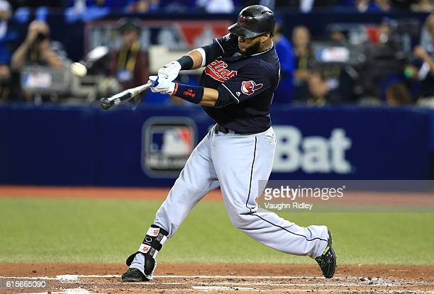 Carlos Santana of the Cleveland Indians hits a solo home run in the third inning against Marco Estrada of the Toronto Blue Jays during game five of...