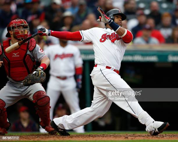 Carlos Santana of the Cleveland Indians hits a two run home run off Lisalverto Bonilla of the Cincinnati Reds as catcher Tucker Barnhart looks on...