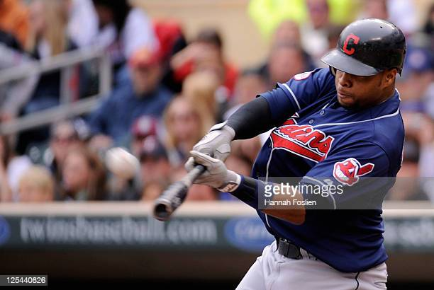 Carlos Santana of the Cleveland Indians hits a two run home run against the Minnesota Twins in the second inning on September 17 2011 at Target Field...