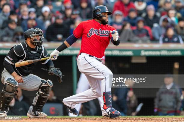 Carlos Santana of the Cleveland Indians hits an RBI single during the sixth inning against the Chicago White Sox at Progressive Field during the...