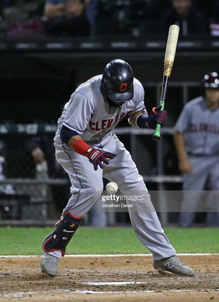 Carlos Santana #41 of the Cleveland Indians is hit in the leg by a pitch in the 7th inning against the Chicago White Sox at Guaranteed Rate Field on September 5, 2017 in Chicago, Illinois.