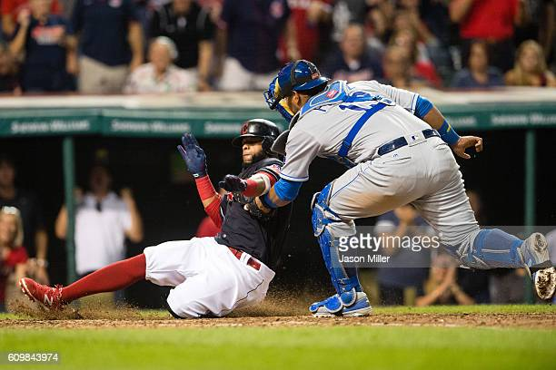 Carlos Santana of the Cleveland Indians is tagged out at home by catcher Salvador Perez of the Kansas City Royals to end the eighth inning at...