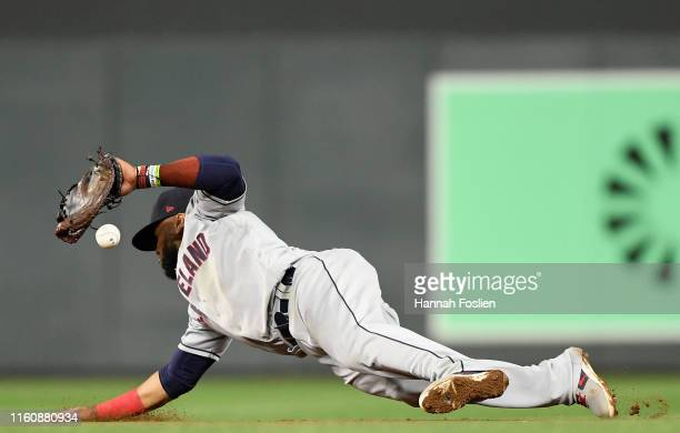 Carlos Santana of the Cleveland Indians is unable to field a single by Jorge Polanco of the Minnesota Twins during the seventh inning of the game on...