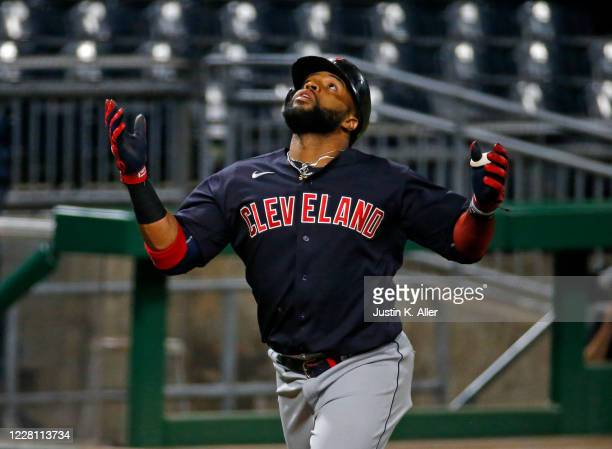Carlos Santana of the Cleveland Indians reacts after hitting a three tun home run in the sixth inning against the Pittsburgh Pirates at PNC Park on...
