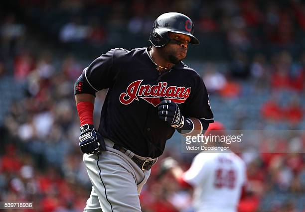 Carlos Santana of the Cleveland Indians rounds first base after hitting a tworun homerun against pitcher Fernando Salas of the Los Angeles Angels of...