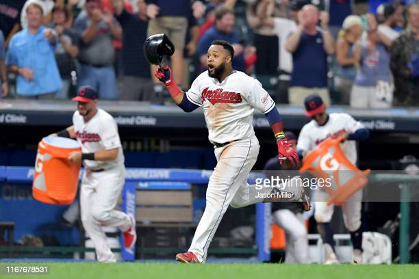 Carlos Santana of the Cleveland Indians rounds the bases on his walk-off solo home run to defeat the Boston Red Sox 6-5 at Progressive Field on...