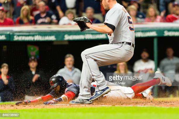 Carlos Santana of the Cleveland Indians scores on a wild pitch by Drew VerHagen of the Detroit Tigers during the sixth inning at Progressive Field on...