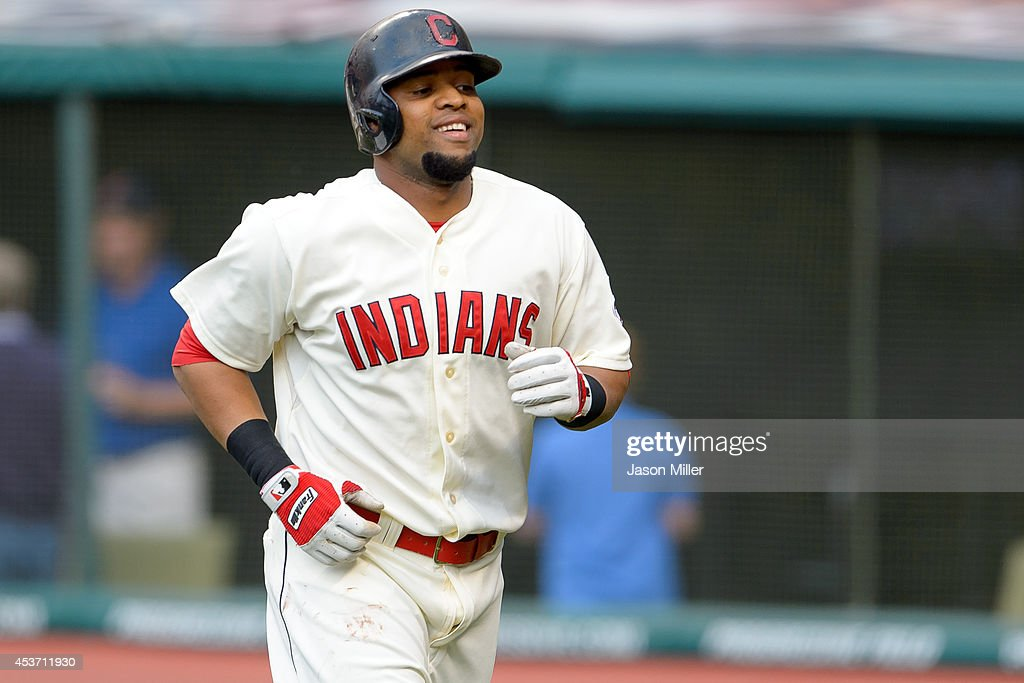 Carlos Santana #41 of the Cleveland Indians smiles after hitting a three-run home run during the first inning against the Baltimore Orioles at Progressive Field on August 16, 2014 in Cleveland, Ohio.