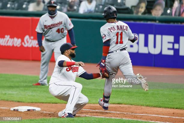 Carlos Santana of the Cleveland Indians tags out Jorge Polanco of the Minnesota Twins at first base during the seventh inning at Progressive Field on...