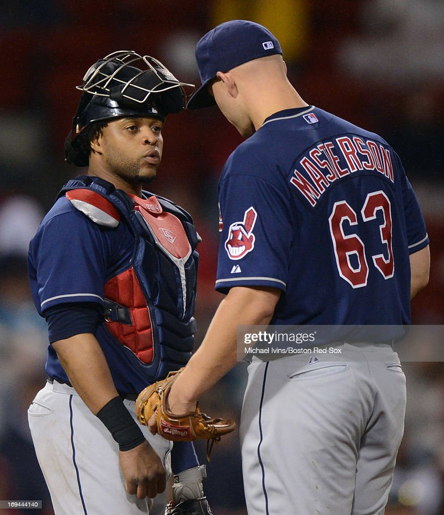 Carlos Santana #41 of the Cleveland Indians talks to teammate Justin Masterson #63 after he gave up three runs to the Boston Red Sox during the third inning on May 24, 2013 at Fenway Park in Boston, Massachusetts.