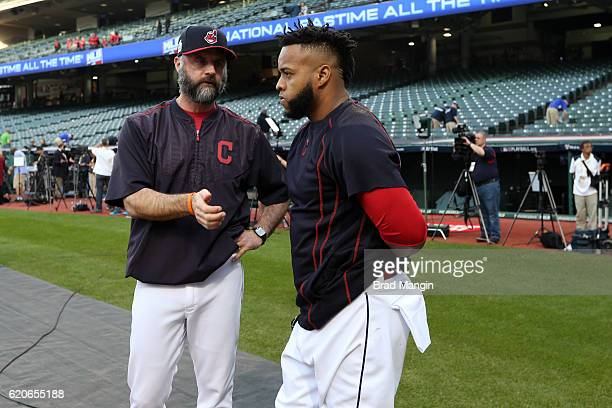 Carlos Santana of the Cleveland Indians talks with Pitching Coach Mickey Callaway prior to Game 7 of the 2016 World Series against the Chicago Cubs...