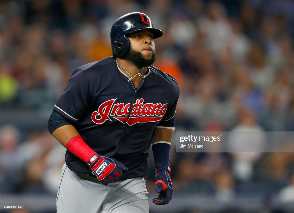 Carlos Santana #41 of the Cleveland Indians watches the flight of his seventh inning home run against the New York Yankees at Yankee Stadium on August 28, 2017 in the Bronx borough of New York City.