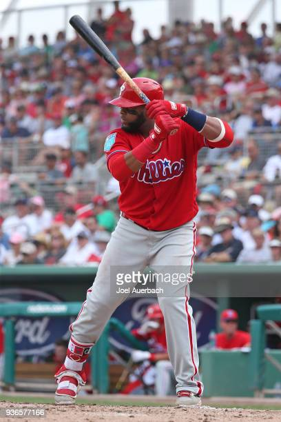 Carlos Santana of the Philadelphia Phillies bats against the Boston Red Sox during a spring training game at JetBlue Park on March 19 2018 in Fort...