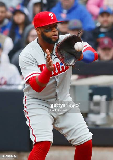 Carlos Santana of the Philadelphia Phillies catches a throw to first base for a force out in an MLB baseball game against the New York Mets on April...