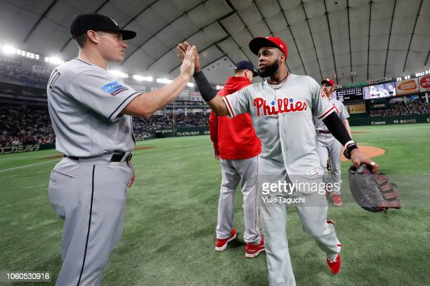 Carlos Santana of the Philadelphia Phillies celebrate after the MLB AllStars defeated Team Japan 73 during the Japan AllStar Series game at the Tokyo...