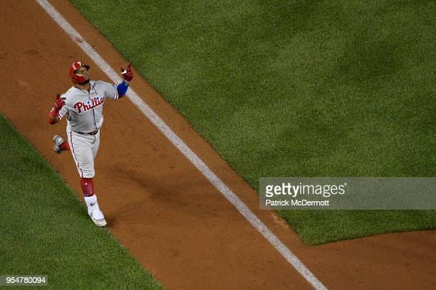 Carlos Santana of the Philadelphia Phillies celebrates after hitting a tworun home run in the sixth inning against the Washington Nationals at...