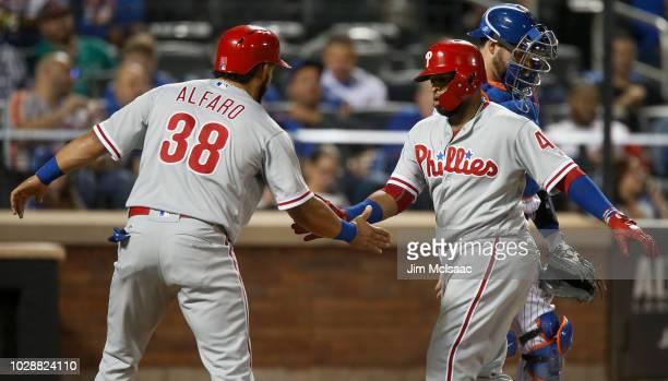 Carlos Santana of the Philadelphia Phillies celebrates his third inning two run home run against the New York Mets with teammate Jorge Alfaro at Citi...