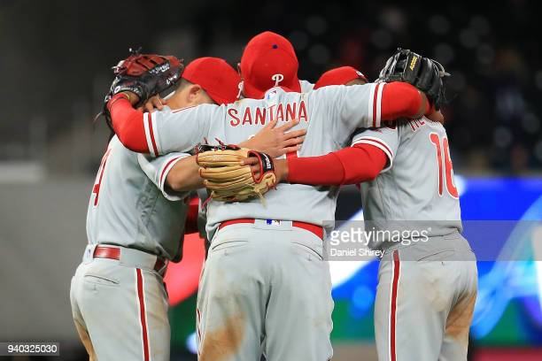 Carlos Santana of the Philadelphia Phillies celebrates with his teammates after beating the Atlanta Braves in eleven innings at SunTrust Park on...